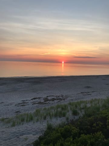 Cape cod Multi-unit building. One Bedroom with loft and futon. Sleeps 4 adults ,Private beach.  Large deck with outdoor grill and outdoor shower   Two parking spots and extra parking available.  Beautiful sunrise and sunsets. Fishing from your own beach