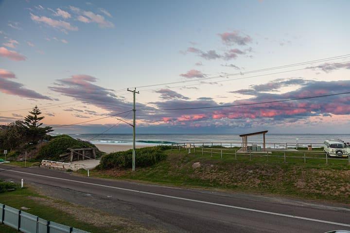 Sunset over the beach from the verandah