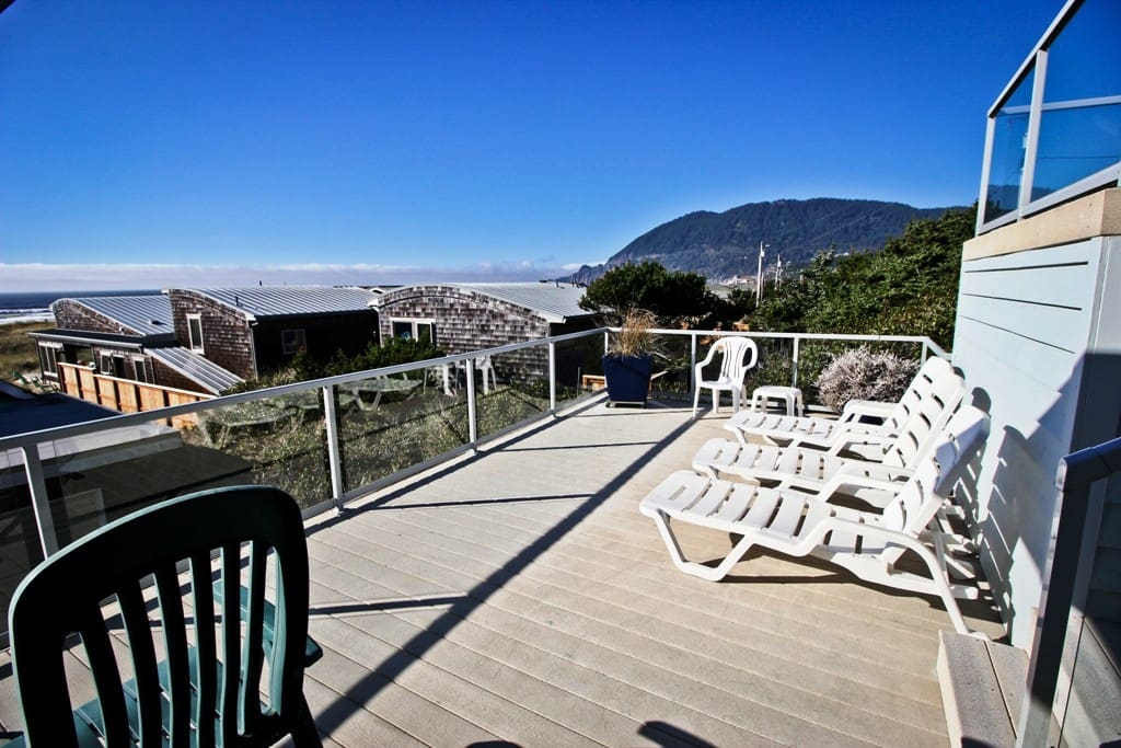 Large dual level private deck off the master bedroom with patio furniture and spectacular ocean views