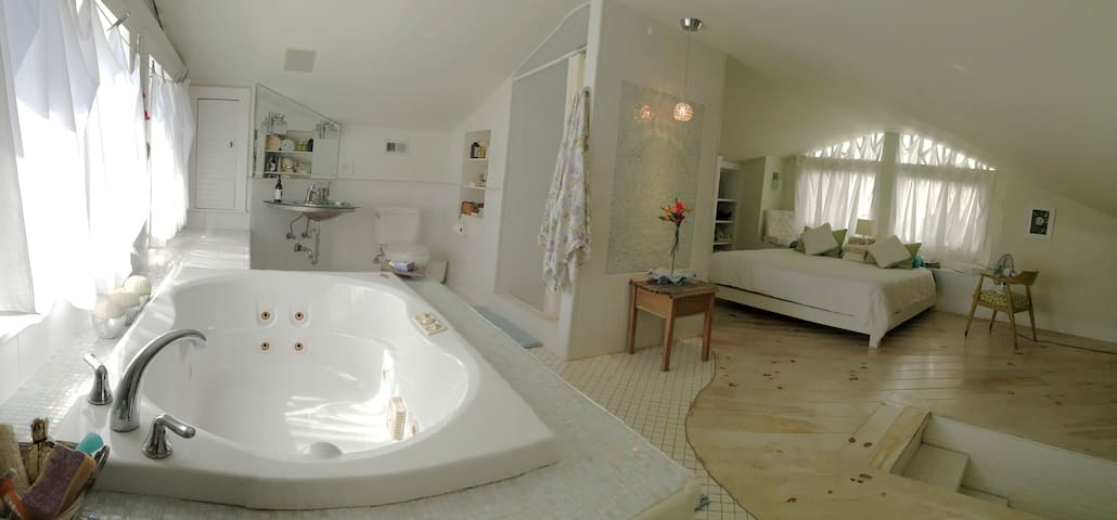 BATH 2 - in Open Master Suite with shower & jacuzzi bath. Cozy quarters for a quiet afternoon nap.