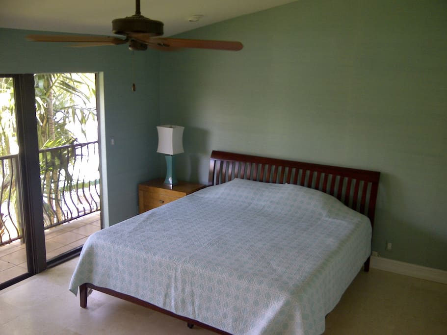 Master with king sized bed with view of Intracoastal with large private bathroom and reach in closet, small flat screen TV