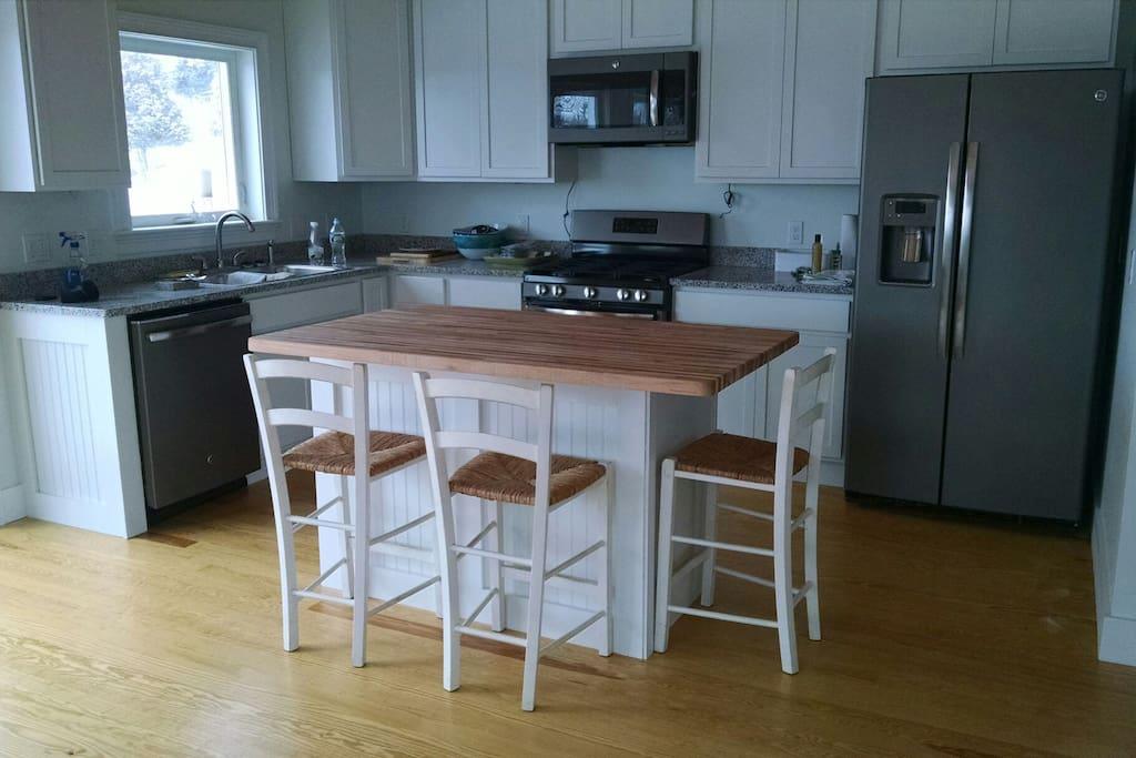 Granite countertop, butcher block island and all new appliances including five burner gas range and granite countertop