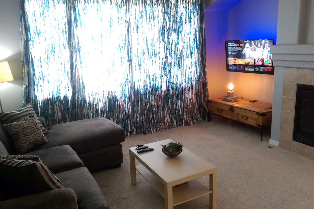 living area with HBO, NETFLIX, and AMAZON PRIME