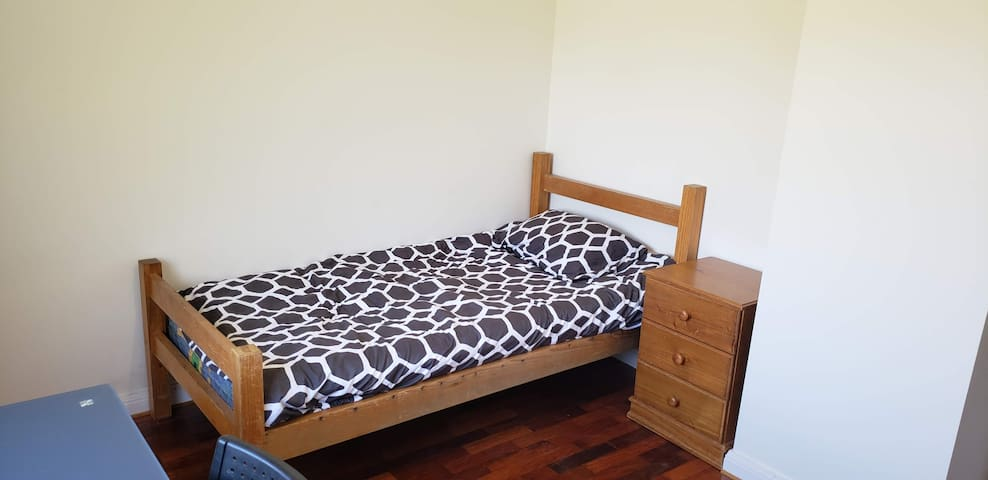 Bedroom in new home near CBD, shops and parks