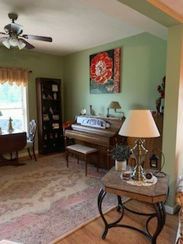 Piano room next to living room