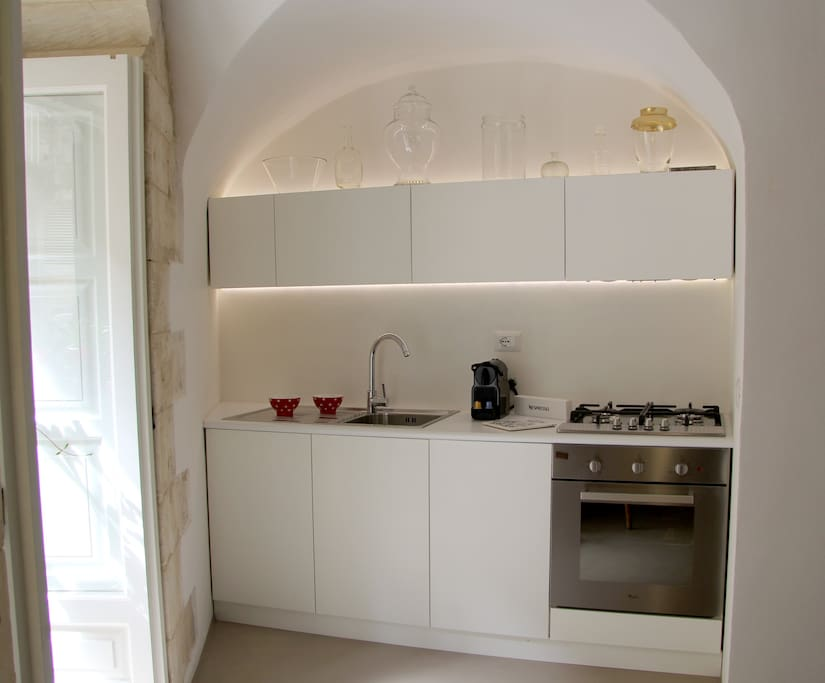 The equipped kitchen with kitchen stove,  oven, sink and everything you need to cook