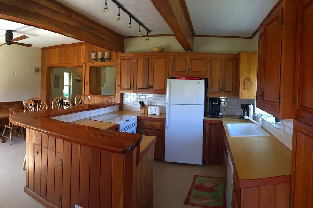 Kitchen is fully equipped with everything you can think of with amble supply of cookware and dishes.  Kitchen bar sits three stools comfortably. eat-in Kitchen includes table that seats four with two table leafs for added room to seat six-eight