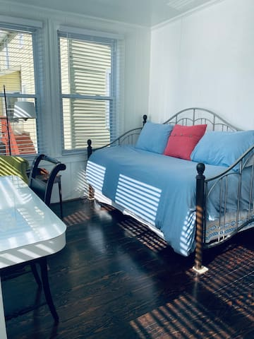 Bedroom #3 has two twin beds with a trundle under the day bed. Perfect for kids.