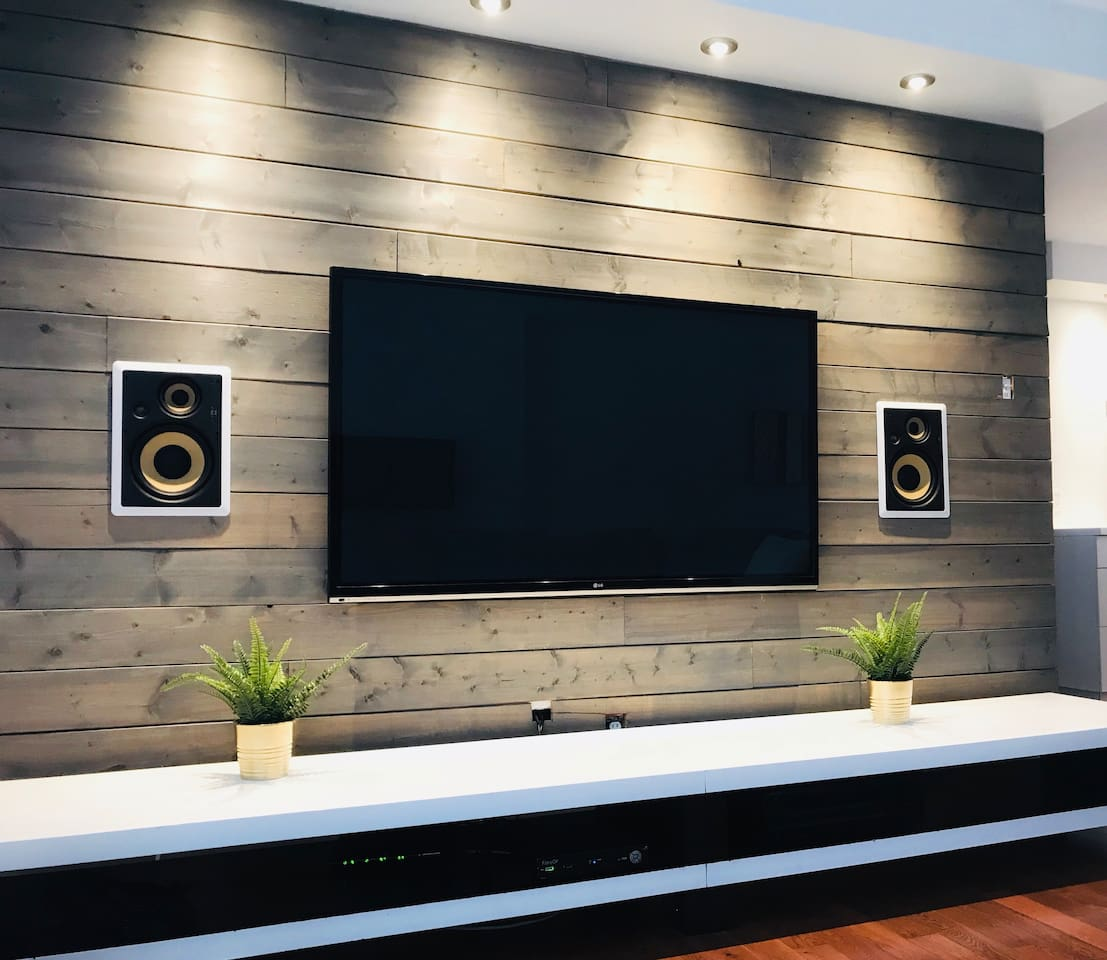 """Living room with 60"""" TV with Netflix and Apple TV"""
