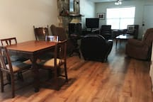 Dining Room / Living Room. The table has leaves tucked underneath; will expand to seat 6.
