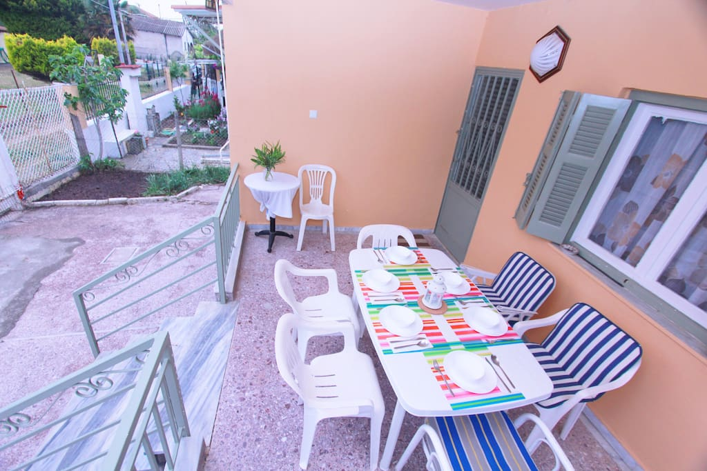 Terrace with dining table , entrance.