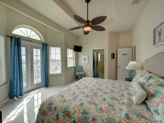 Top floor master suite with large bath, jacuzzi and private deck.