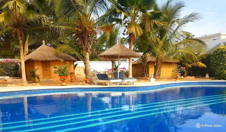 Charmante case africaine parc exceptionnel piscine