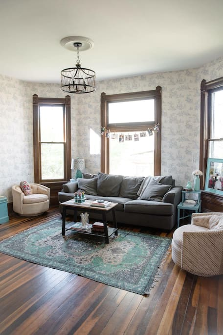 Our beautiful living room with original hardwood floor and windows!