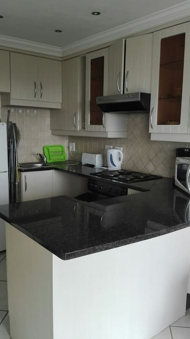 Fully equipped kitchen with stove and oven hob