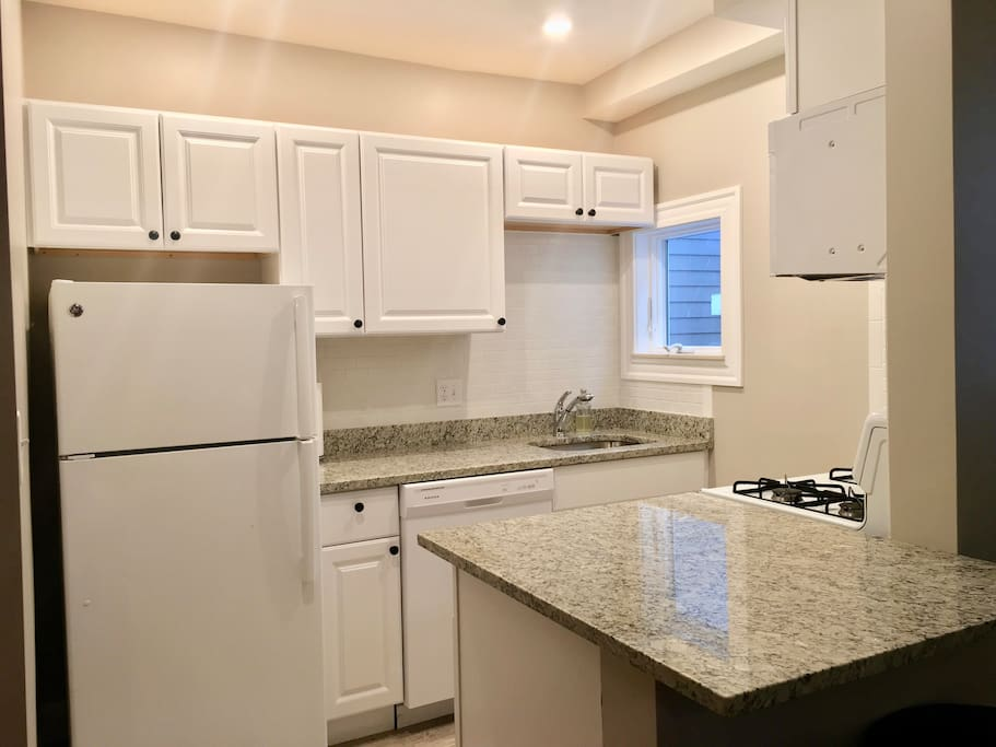 Eat-in kitchen comes with dishwasher and all cooking amenities and eating utensils.