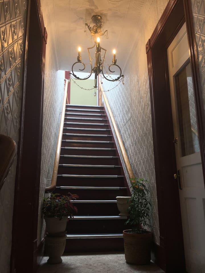 original tin wallpaper and stairway railings