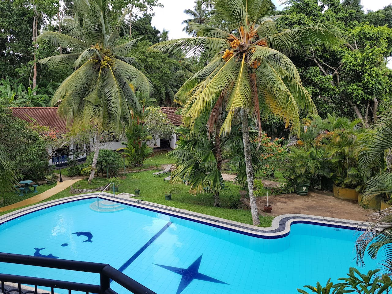 View of Leijay pool, garden and 2 bungalows