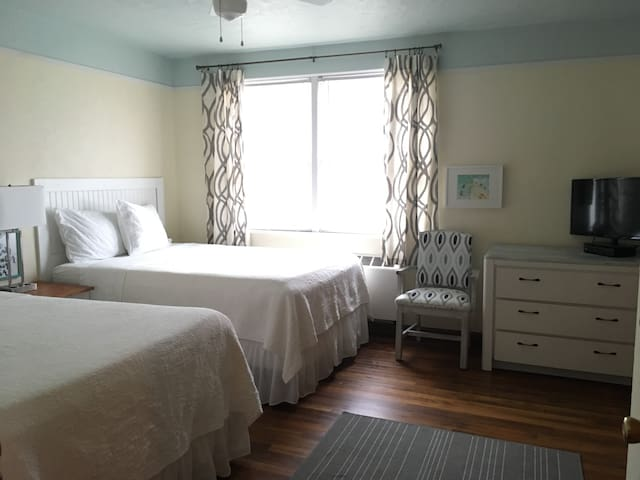 Coastal and casual decor with two double beds