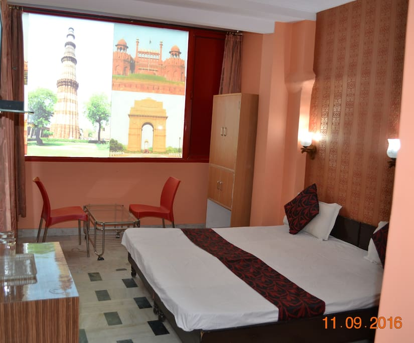 Deluxe Double Bed AC Room with a balcony