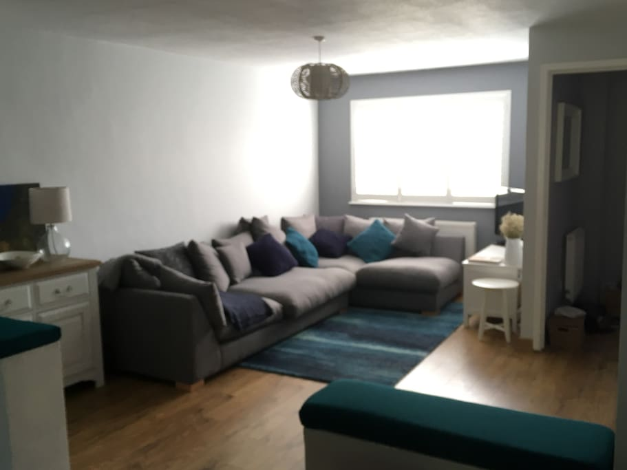 Living Area - large sofa, TV (with BT Sport)