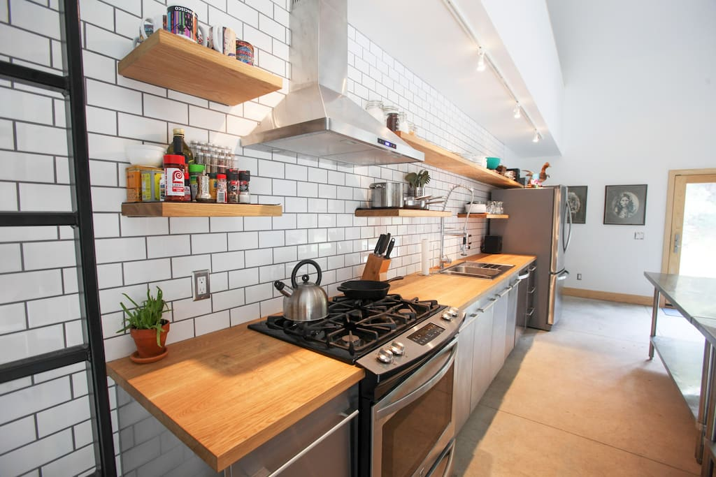 The kitchen comes fully stocked with tools of the trade for enjoying an elegant meal or preparing for bbq on the fire pit out back