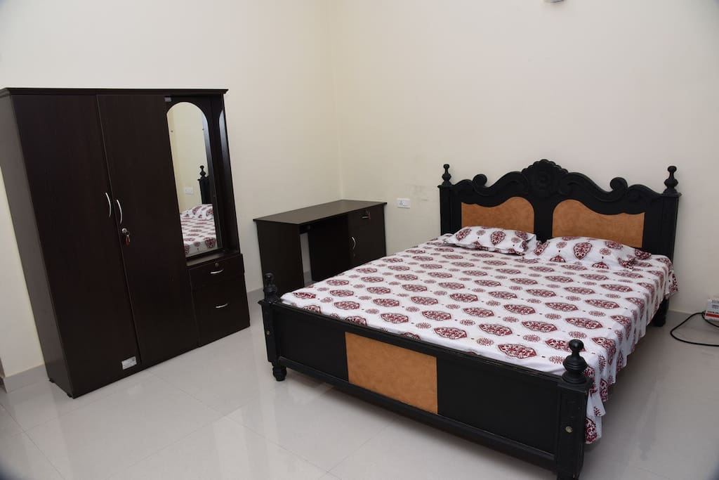 Master Bedroom  King size Bed having Wardrobe with mirror and writing Table furnished with Air-Conditioner