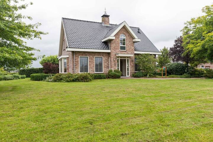 Pretty Farmhouse in Genderen with Terrace and Garden