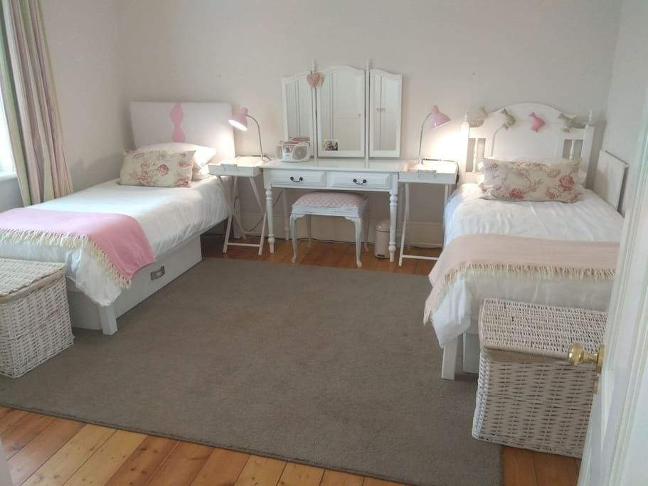 Air-conditioned bedroom with 2 three-quarter beds.