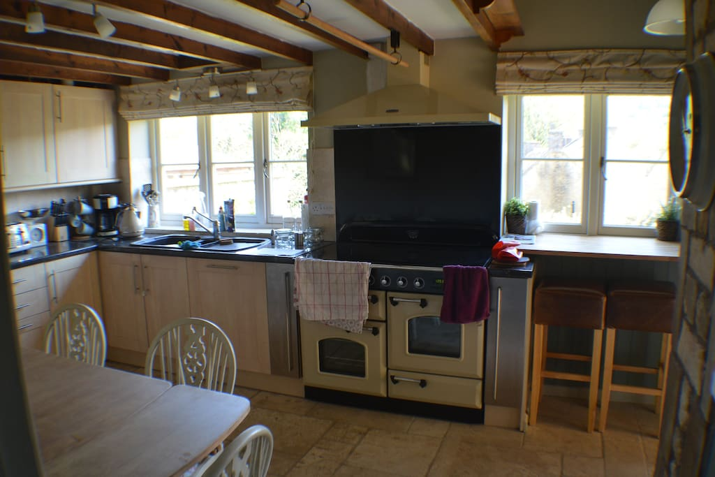 Kitchen with large brand new RangeMaster induction oven. The oven has 5 rings on the hob, two ovens , a warming oven for plates and a storage drawer for backing trays.