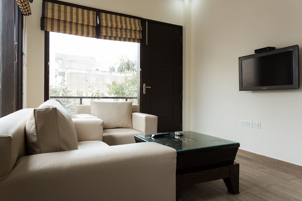 Your own Living Room with sofa seating and Flat screen TV with Tata Sky HD