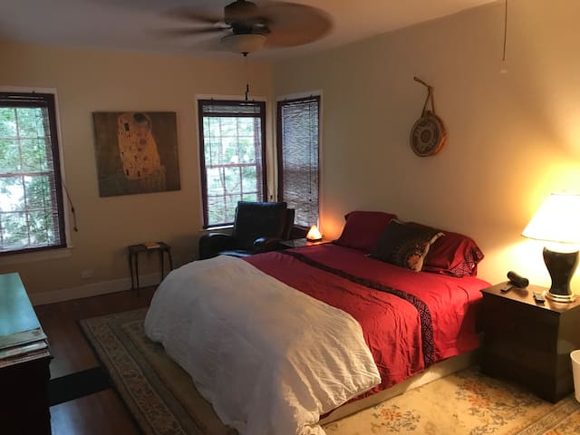 Master Bedroom. Tree-lined windows are wonderful to wake up to!