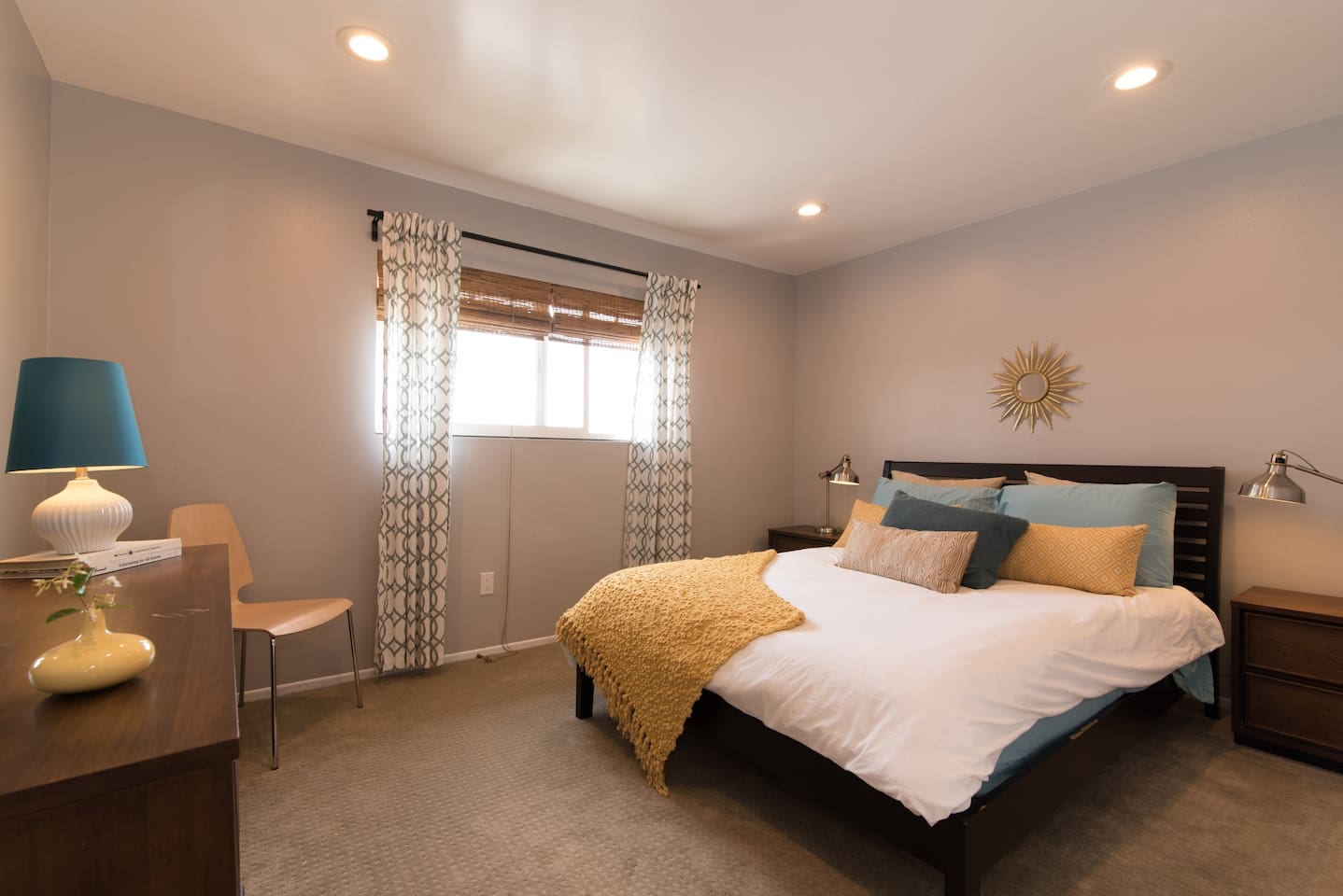 Dream big in the Hide-Away bedroom. Relax away the day in the queen size bed and Mid Century Modern feel.