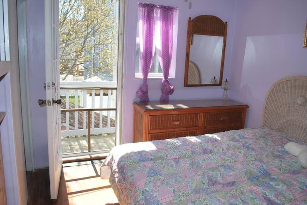 1 full size bed and small deck with 2 chairs and table room also has one small desk and closets
