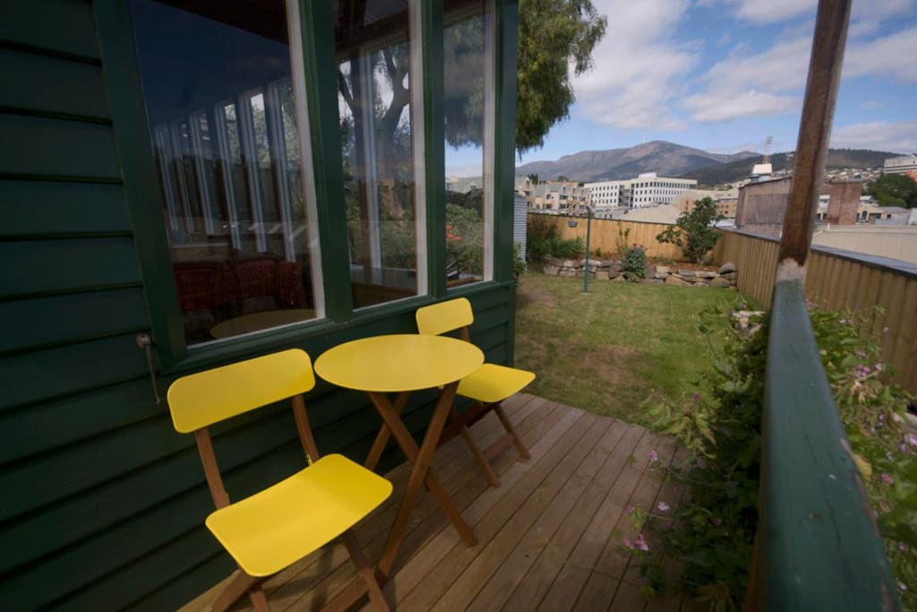 BACKYARD: The deck with views of Mount Wellington