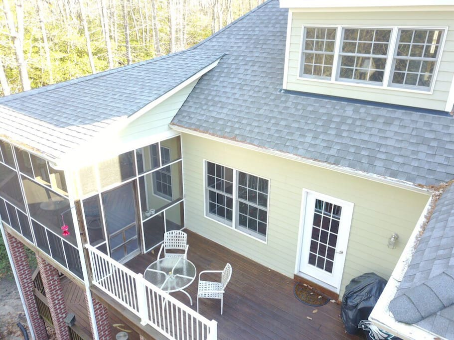 Rear view with screen porch to enjoy in weather