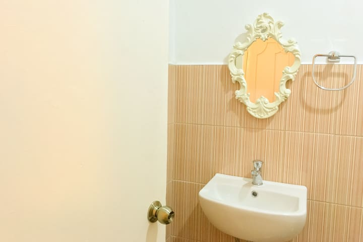 Yellow Room - vintage mirror in the bathroom