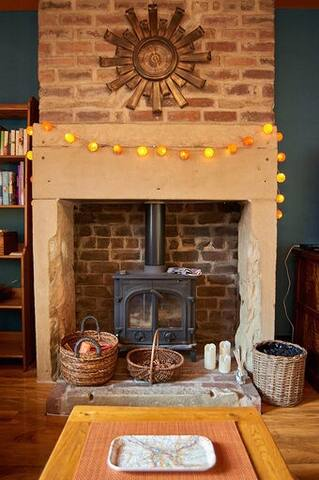 Wood burning stove fire to make a cosy and warm lounge.