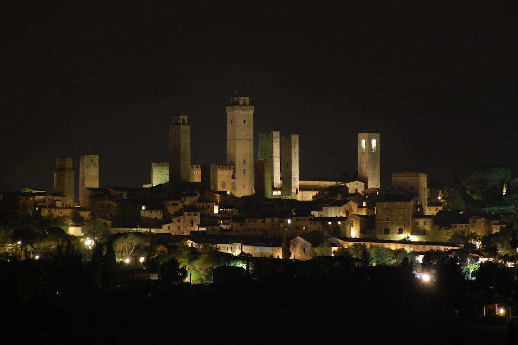 San Gimignano from one of the Montegonfoli FOUR bedrooms and from the garden, swimming pool and lounge.