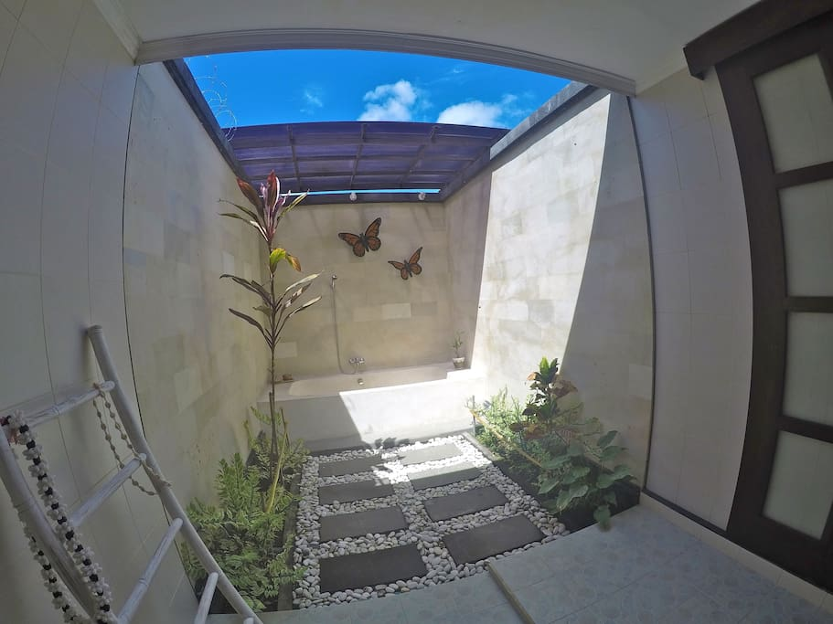 lime stone open toilet with bath