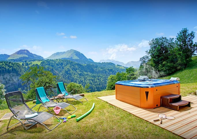 Admire views from the hot tub at this stunning Alpine home - OVO Network