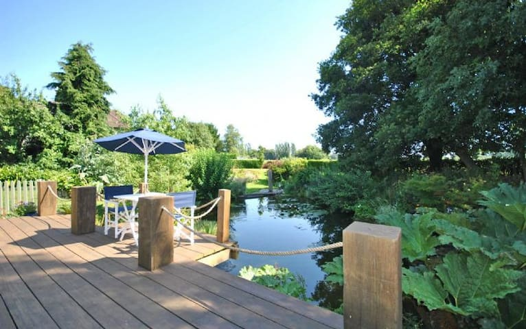 outside dining overlooking the natural pond for those warm summer evenings