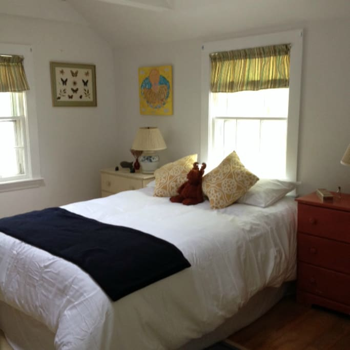 Recently renovated guest bedroom with full bed and loft to a set of twin beds upstairs.