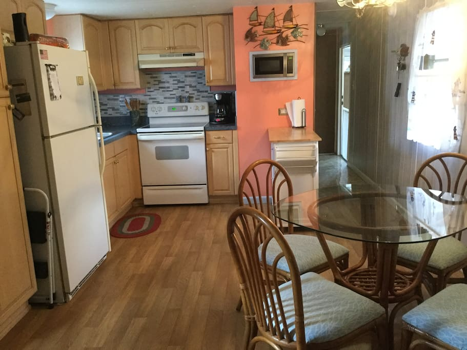 An open kitchen with seating close by