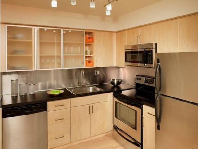 Modern Kitchen with microwave and range and dishwasher