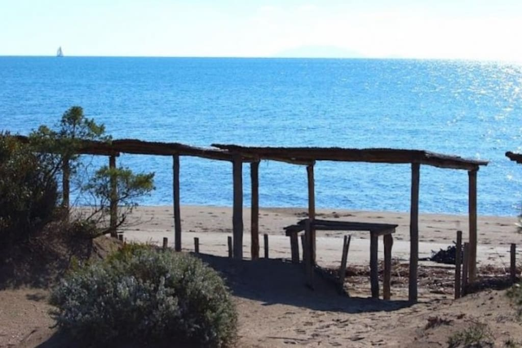 Beach private gazebo, loungers, table and changing room.