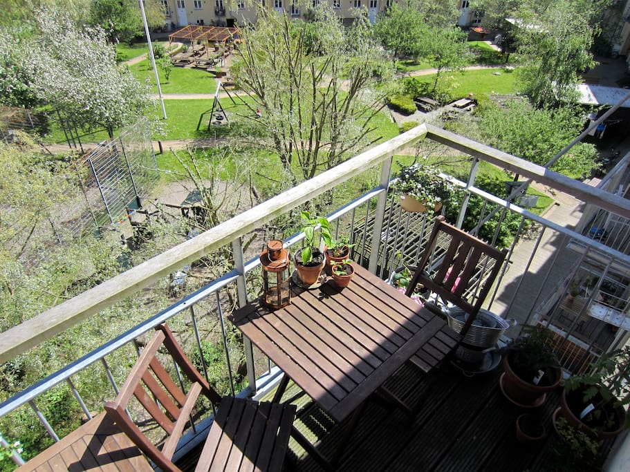 From the sunny balcony you have a view of the beautiful, big, green yard.