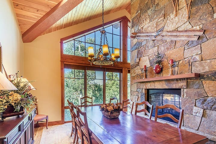 Dining area with seating for 8, two sided fireplace opens to the dining and living area
