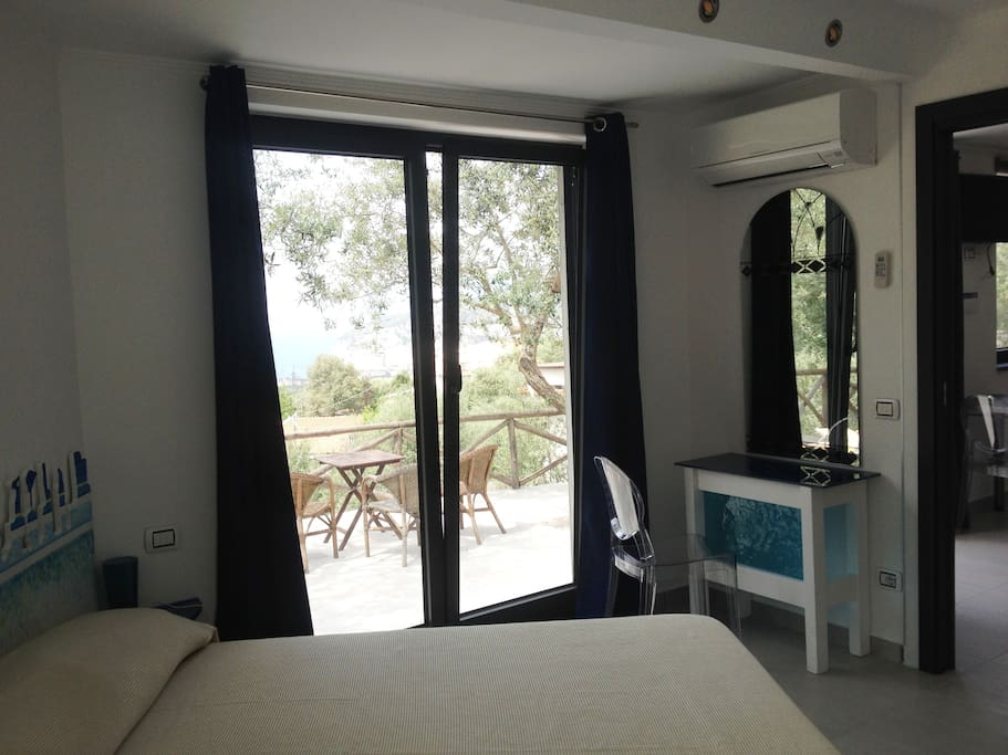 Bed room with the sea view of Naples bay, large outdoor terrace.