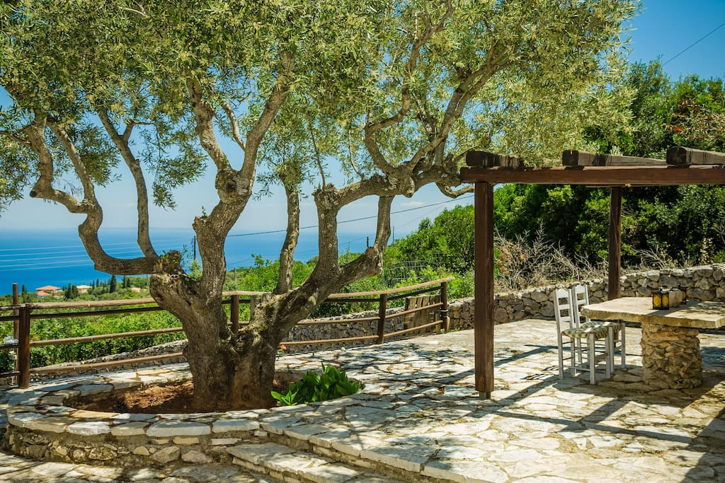 The private furnished veranda of the Maisonette, with pergola and its breathtaking views